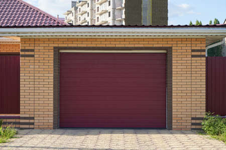Garage with automatic lifting brown door Stock Photo