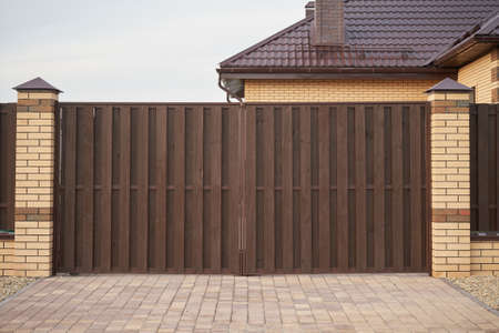 Brown wooden gate and fence Banco de Imagens