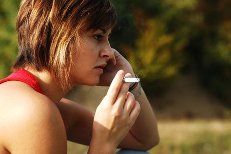 girl smoking outdoors photo