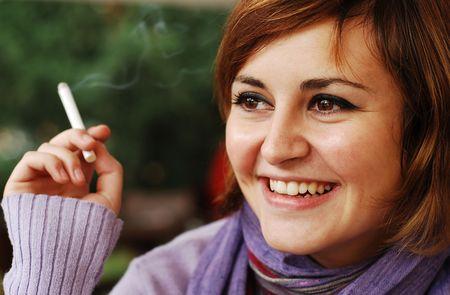 cigar smoking woman: young woman smoking Stock Photo