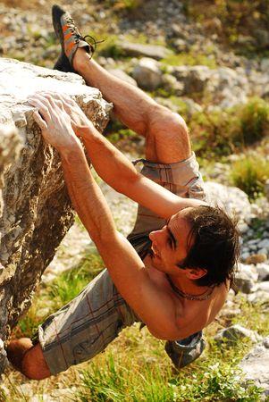 bouldering: scalatore maschile  Archivio Fotografico