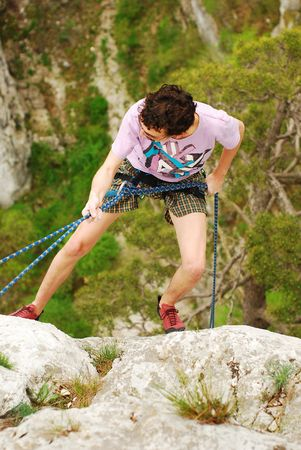 rappelling: climber rappelling