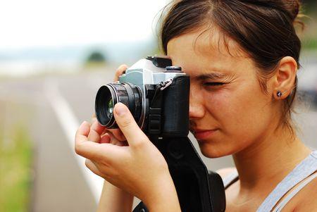 analog camera: young female photographer