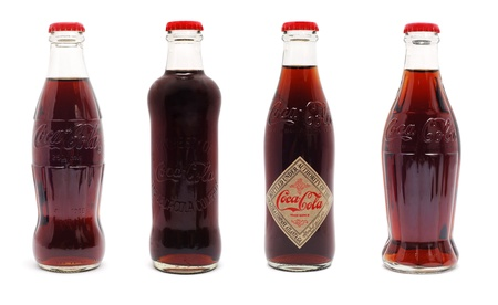 Caransebes, Romania - June 15th, 2011, Coca Cola limited edition 125 years anniversary bottles isolated on white