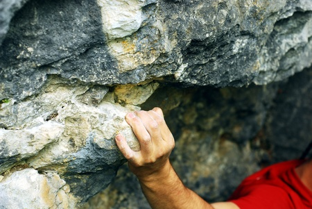limestone: climber holding a grip on the rocks