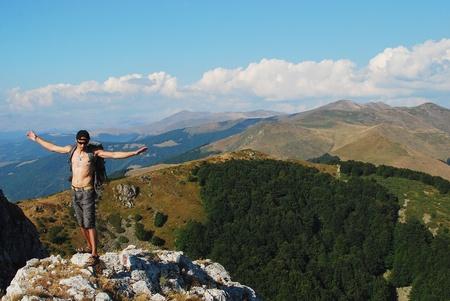 man on the mountain top photo