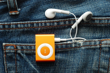 Caransebes, Romania, December, 1st, 2011 - iPod Shuffle with earphones in jeans pocket 報道画像