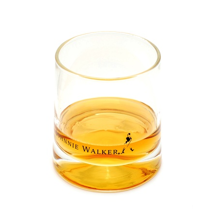 Caransebes, Romania, December, 12th, 2011 - Johnny Walker whiskey shot isolated on white Stock Photo - 11459174