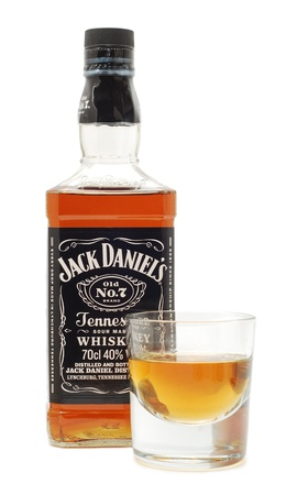 Caransebes, Romania, December, 12th, 2011 - Jack Daniels whiskey bottle, with shot, isolated on white