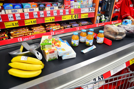 products on the conveyor belt at the supermarket