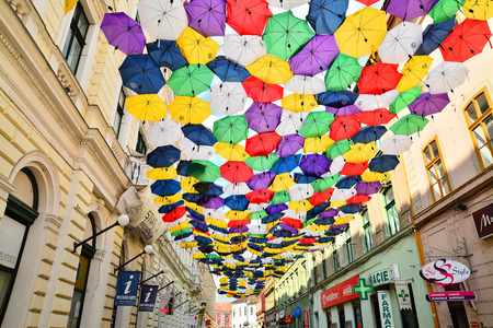 street decorated with umbrellas