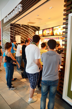 People buying food at the Mc Donald s