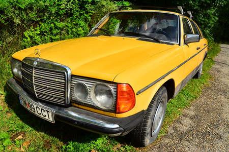 benz: an old, retro, yellow mercedes benz
