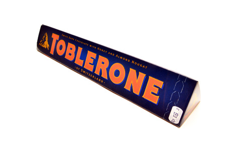 toblerone: a toblerone chocolate bar isolated on white