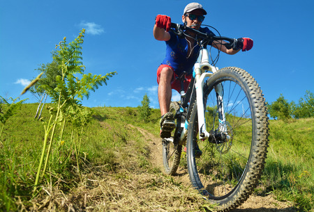 mountainbike: downhill rider on the trail Stock Photo