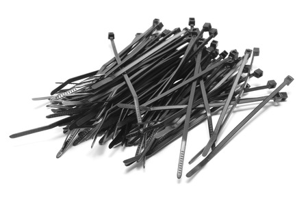 tie: black plastic cable ties isolated on white Stock Photo