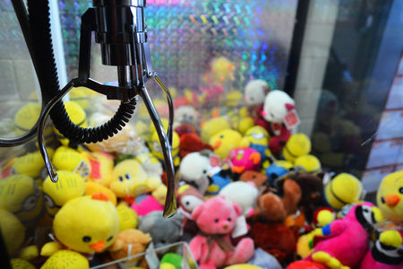 plush toys: claw vending machine with toys Stock Photo