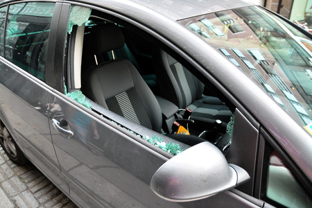 smashed: broken car windshield, car theft