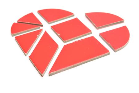 broken heart made of tangram game pieces Stock Photo