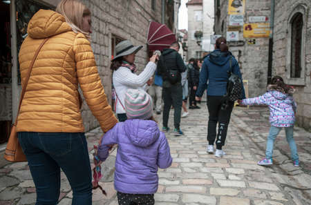 Montenegro, Apr 30, 2019: Street scene with tourists and locals on the street of Kotor Old Town Редакционное