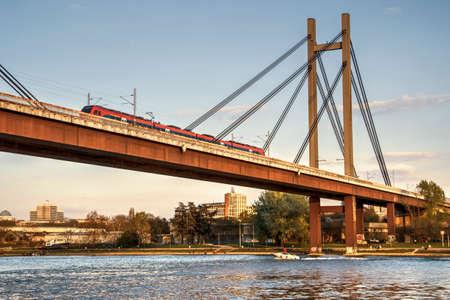 Passenger train crossing the bridge Banque d'images
