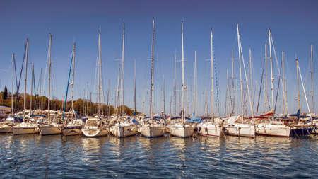 Istria, Croatia - Row of sailing yachts moored in a marina placed in Istrian coastal village of Funtana