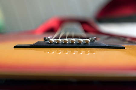 Close-up of an acoustic guitar lying in its case
