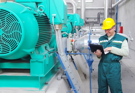 Industrial worker with notebook Stock Photo - 15501875