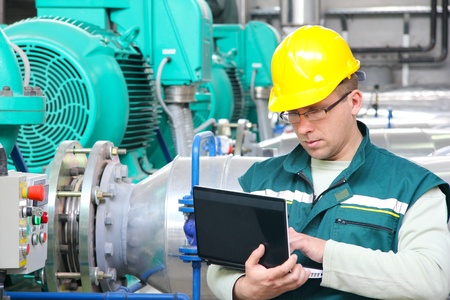 electronics industry: Industrial worker with notebook