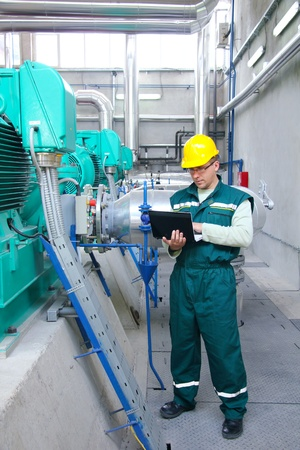 helmet safety: Industrial worker with notebook
