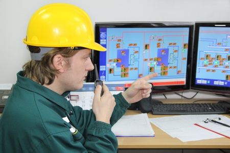 Industrial worker in control room Stock Photo - 15261259