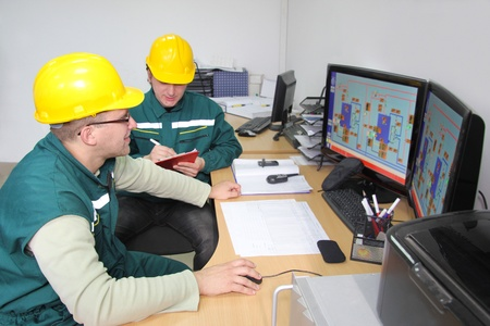 electronics industry: Industrial workers in control room