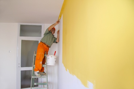 painters: Painter in action, interior decoration Stock Photo