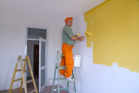 Painter in action, interior decoration Stock Photo