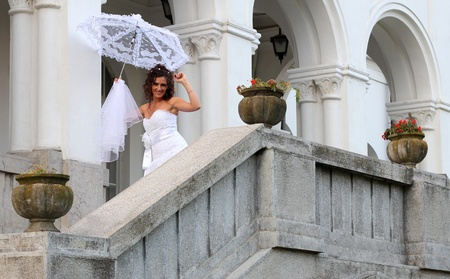 Happy bride on the balcony of the castle Stock Photo - 15693740