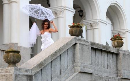 Happy bride on the balcony of the castle Stock Photo - 15693740