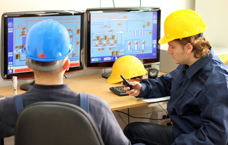 Industrial workers in control room Stock Photo - 15693732