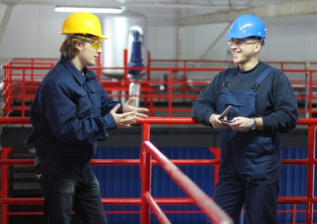 Workers talking in a factory photo