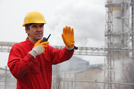 Industrial Worker, controls work in a factory