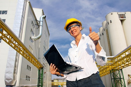 Smiling Businesswoman with Notebook