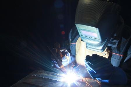 Welder at work in metal industry Stock Photo - 16156100