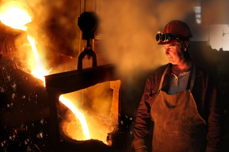 red hot iron: Hard work in a foundry, melting iron