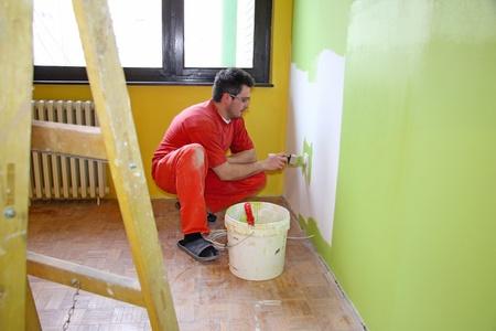 Painter in action, interior decoration photo