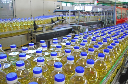 packaging industry: Sunflower oil in the bottle moving on production line