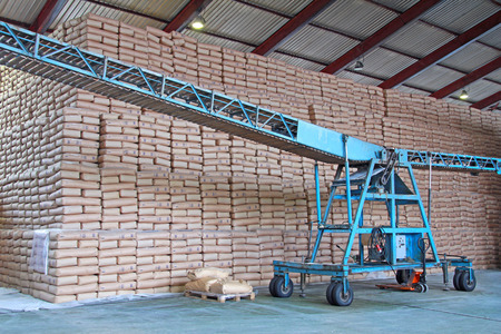 paper factory: Sweet Wall - Sacks of Sugar and Conveyor in a Warehouse