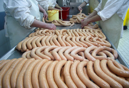 Making sausages, food production in the factory