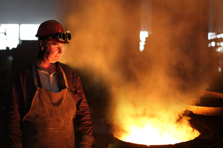 Industrial worker in a foundry photo