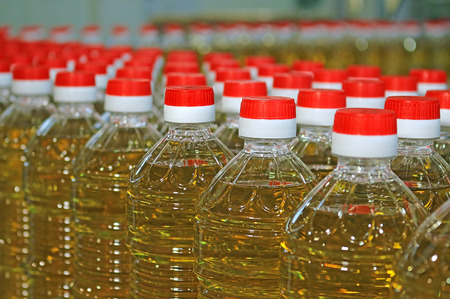 processed: Sunflower oil in the bottle moving on production line