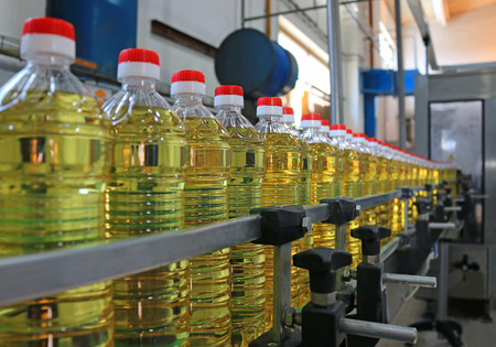 Sunflower oil in the bottle moving on production line