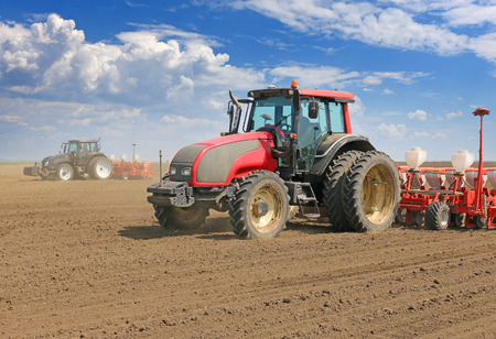 agronomic: Tractor and Seeder Planting Crops on a Field